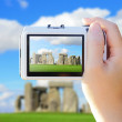Camera taking photo with Stonehenge — Stock Photo #55634639