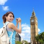 Woman taking photo of Big Ben — Stock Photo #55634895