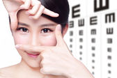 Woman and eye test chart — ストック写真