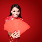 Woman holding red envelopes — Stock Photo