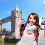 Woman tourist taking photo — Stock Photo #61277303