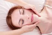 Woman enjoying face massage — Stock Photo
