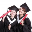 Students holding diplomas — Stock Photo #69483235
