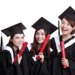 Students holding diplomas — Stock Photo #69483241