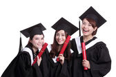 Students holding diplomas — Stock Photo