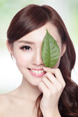Woman face portrait with green leaf — Stock Photo