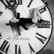 Slim beautiful female on the giant clock — Stockfoto #62342443