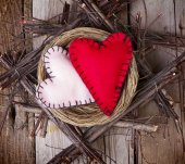Two felt hearts in a wooden nest — Stock Photo
