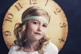 Young girl with large vintage clock — Foto Stock