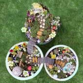 Birds eye view of fairy garden in a flower pot — Stock Photo