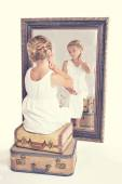 Child or young girl staring at herself in a mirror — Stock Photo
