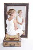 Child or young girl in front of a mirror — Stock Photo