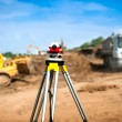 Surveyor equipment optical level or theodolite at construction site — Stock Photo #51826665