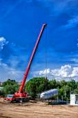 Mobile industrial crane installing a concrete and cement production plant — Stock Photo