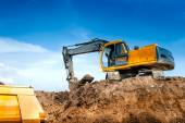 Construction site digger, excavator and dumper truck. industrial machinery on building site — Stock Photo