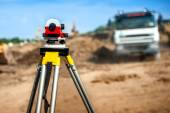 Surveyor engineering equipment with theodolite at highway infrastructure construction site — Stock Photo