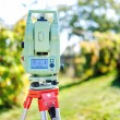 Surveying equipment with transit total station and theodolite with garden background — Stock Photo