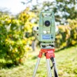 Surveyor engineering equipment with theodolite and total station in a garden at a construction site — Stock Photo #53567999