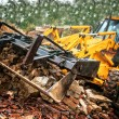 Excavator loading demolition debris and concrete wasted walls — Stock Photo #56066723