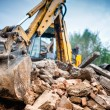 Hydraulic crusher excavator backhoe machinery working on site demolition — Stock Photo #56066773