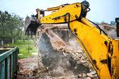 Bulldozer and excavator demolishing concrete brick walls — Stock Photo