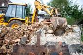 Industrial machinery working with debris and dust, loading a dumper truck — Stock Photo