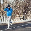 Professional boxer and athlete working out outdoor on snow and cold air.Jogger training for marathon — Stock Photo #61693401