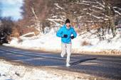 Active man, jogging and running during a sunny winter day. Outdoor working out concept — Stock Photo