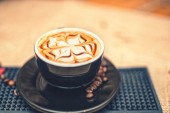 Freshly brewed coffee on the counter at local pub, mixed with milk. Soft effect. — Stock Photo