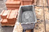 Mud pan with cement and mortar for bricklaying on construction site — Stock Photo