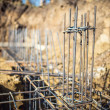 Detail of infrastructure - Reinforced steel bars on new construction foundation site — Stock Photo #65402579