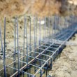 Foundation site of new building, details and reinforcements with steel bars and wire rod, preparing for cement pouring — Stock Photo #65402589