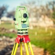 Surveyor engineering equipment with theodolite and total station at a construction site — Stock Photo #65402635