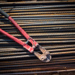 Reinforced steel bars and bolt cutter on building construction site — Stock Photo #65402643