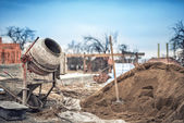 Cement mixer machine at construction site, tools and sand — Stock Photo