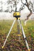 Surveying measuring equipment level theodolite on tripod  — Stock Photo