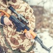 Постер, плакат: Details of equipment and gun on military ranger War hunting or protection concept with man