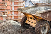 Dumper truck unloading construction gravel, sand and curshed stones — Stock Photo