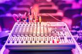 Audio music mixer and sound equalizer, dj equipment and nightclub accesories at party in modern city — Stockfoto