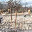Site of new building, details and reinforcements with steel bars and wire rod, preparing for cement pouring — Stock Photo #68790805