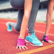 Fitness athlete on starting blocks at stadium track preparing for a sprint. Fitness, healthy lifestyle concept — Stock Photo #72128617