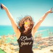 Attractive girl wearing black tank top smiling, laughing and taking pictures with camera phone. Traveling concept with happy woman. Soft colorful effect on photo — Stock Photo #78446848