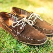 Modern brown leather mens shoes, elegant summer moccasins in grass. Men fashion, men accesories and footwear. — Stock Photo #79890936