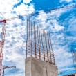 Construction site with industrial crane and close up of reinforced concrete walls, building of skyscraper office building — Stock Photo #80325292