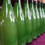 Harvest Festival. Row of New Wine in Green Bottles for Sale — Stock Photo #52335969