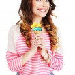 Friendly Woman Holding Ice Cream and Smiling — Stock Photo #53963679