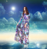 Imagination. Woman in Light Dress is Hovering among Clouds — Stock Photo
