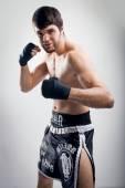 Thai boxing Artem Levin in studio — Stock Photo