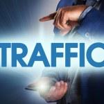 Businessman presses button traffic on virtual screens. Business, — Stock Photo #76104561