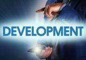 Businessman presses button development on virtual screens. Busin — Stock Photo